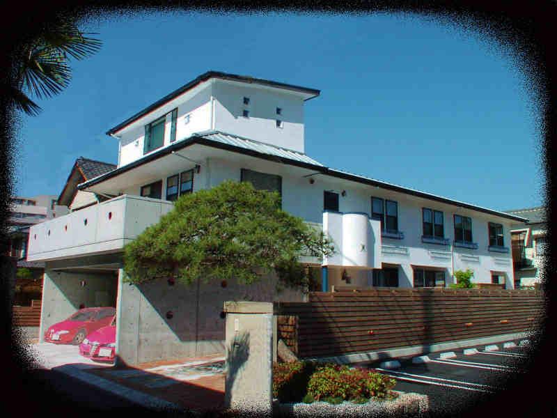 コンクリート打ち放しと漆喰塗りの家(庚午北K邸)
